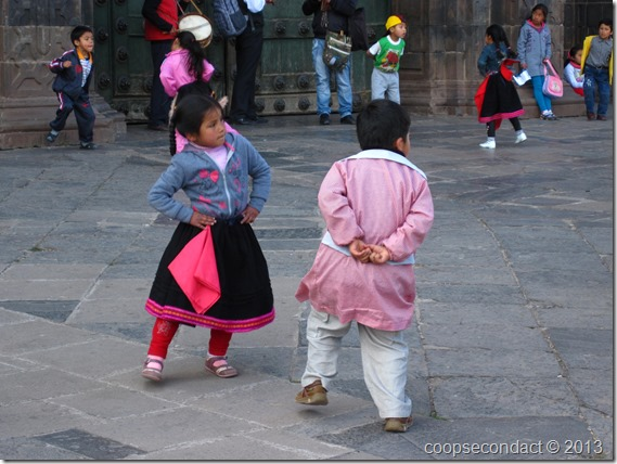 Little children perform around the central plaza