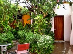 Back patio, view of Master bedroom door and outdoor shower