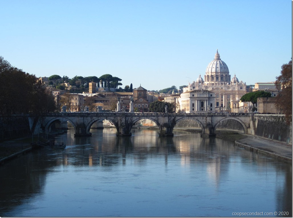 Along the Tiber River in Rome; Dome of St. Peter's Basilica in the background